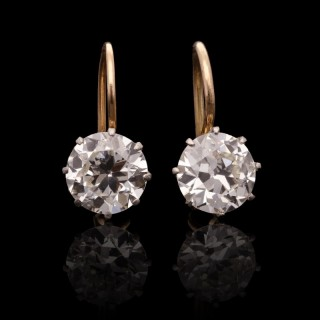 A classic pair of old round brilliant cut diamond earrings weighing 2ct total with hook fittings.