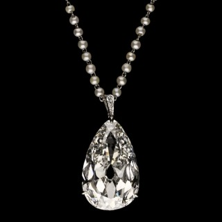 AA magnificent 20.20ct old mine antique pear-shaped diamond set in a pendant suspended from a pearl chain.