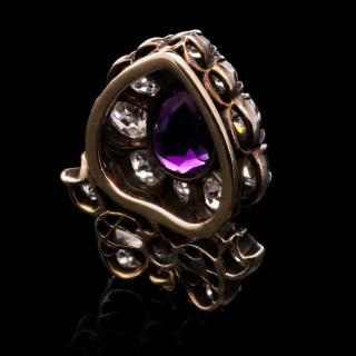 A beautiful antique amethyst and diamond pear shape pendant with ribbon bow surmount.