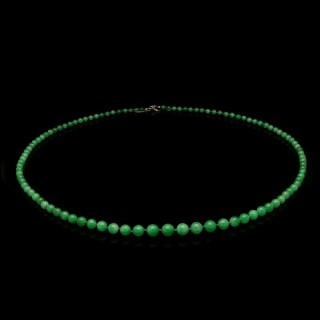 A beautiful long necklace of jadeite jade beads with diamond flower shaped clasp.