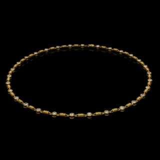 An 18ct yellow gold chain necklace set with approximately 4.5cts of round brilliant diamonds.