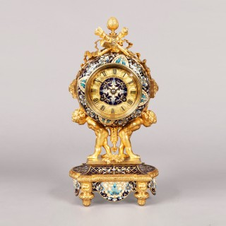 ​​​​​​​A French Mantle Clock Garniture in the Louis XVI Manner