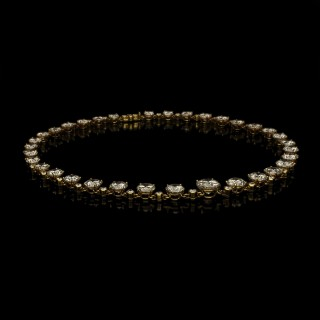 A stunning brilliant-cut diamond riviere necklace in 18ct gold set with over 40cts of diamonds.