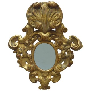 Flamboyantly carved giltwood mirror, Portugal, 18th century circa 1780
