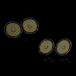 A beautiful set cufflinks & dress buttons with diamond centres and sapphire surrounds.c.1915