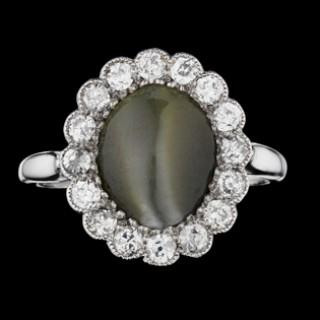 Cat's eye chrysoberyl and diamond coronet cluster ring, circa 1910.