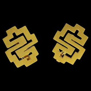A pair of bold geometric clip earrings in 22ct gold from the Choreographism collection. 1977
