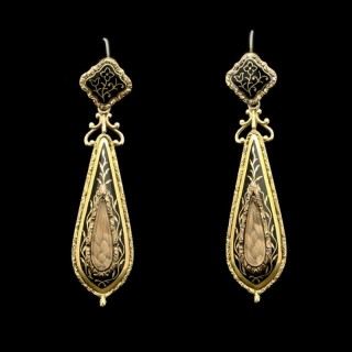 A  very rare and beautiful pair of gold and enamel memorial earrings with central hair glazed panel. c.1840/60