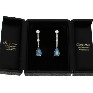 Moonstone and diamond drop earrings, circa 1930.