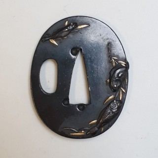 An antique Japanese iron tsuba decorated with fish