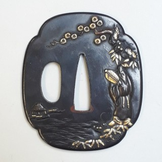 An antique Japanese iron tsuba with multimetal decoration of Fukurokuju