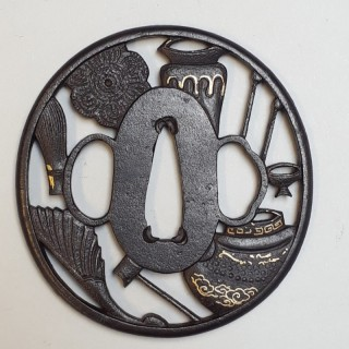 An antique Japanese iron tsuba with peirced decoration
