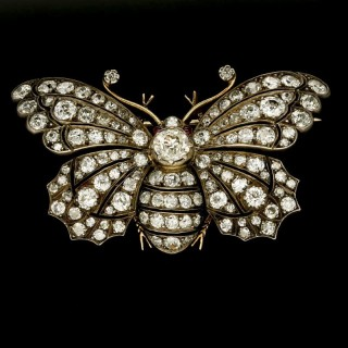 A stunning Victorian  diamond butterfly brooch set en tremblant in silver and gold with ruby eyes. c.1880