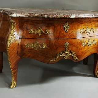A rare early 18th century French Kingwood Louis XV commode of bold proportions