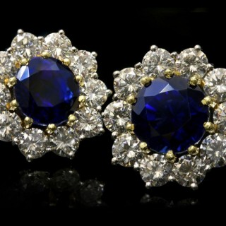 Sapphire and diamond cluster earrings, circa 1970.