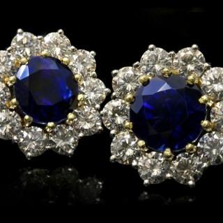 Sapphire and diamond cluster earrings, circa 1970.