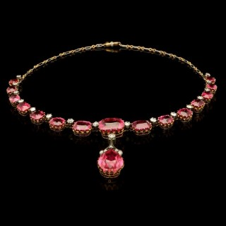 A stunning rubellite tourmaline pendant necklace with old cut diamonds in silver and gold.