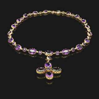 A beautiful antique amethyst and gold chain necklace with detachable cross pendant.