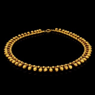 A French 18ct yellow gold fringe-style necklace in the archaeological revivalist style.