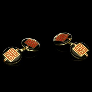 A pair of Art Deco gold and enamel double end cufflinks with Chinese dragon symbol.