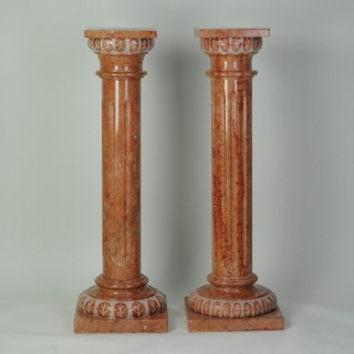 Matched pair of rose marble pedestals