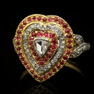 Diamond and ruby heart shape cluster ring, circa 1900.