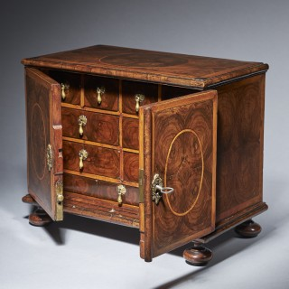 A rare and important late 17th century  olive oyster table cabinet