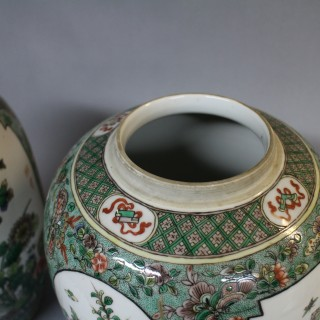 A pair of 19th century Chinese famille verte jars and covers