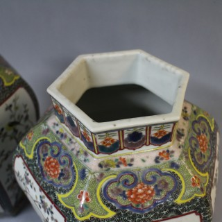 A pair of 19th century Chinese famille verte hexagon shaped jars and covers