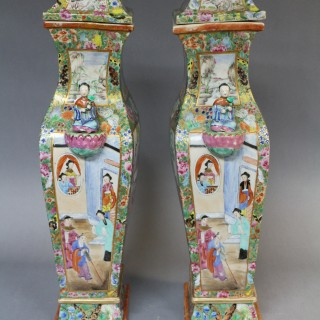 A pair of 19th century canton famille rose jars and covers