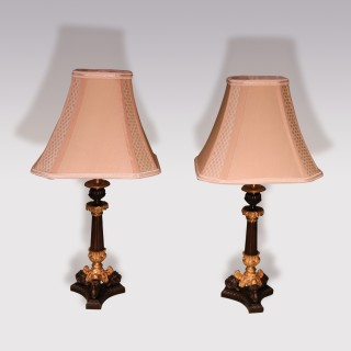 Pair of Bronze and Ormolu Triform Candlestick Lamps