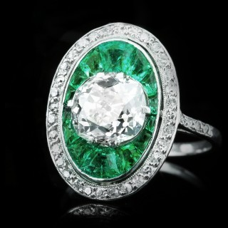 Old mine diamond and emerald cluster ring, circa 1920.