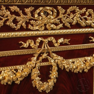 A Fine Louis XVI Style Gilt-Bronze Mounted Mahogany Commode, in the Manner Of Martin Carlin