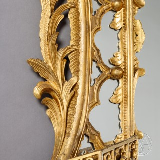 A Fine and Large Pair of George II Style Carved Giltwood Mirrors or Pier Glasses