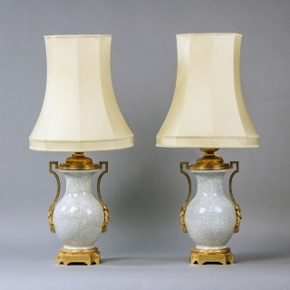 A Pair of Louis XVI Style Gilt-Bronze Mounted Crackle Glazed Porcelain Oil Lamps
