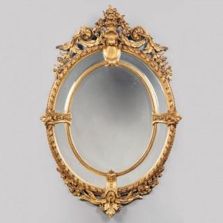 A Fine Napoleon III Carved Giltwood Oval Marginal Frame Mirror
