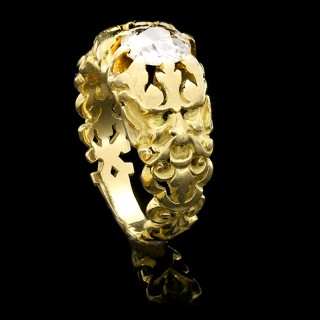 Gothic revival solitaire diamond carved ring, attributed to Wièse, circa 1890.