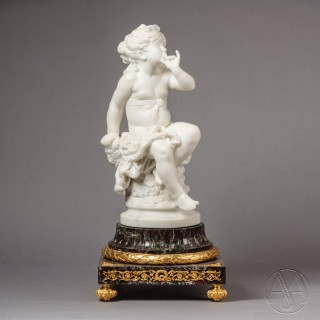 A Finely Carved Carrera Marble Figural Group of A Young Female Putto