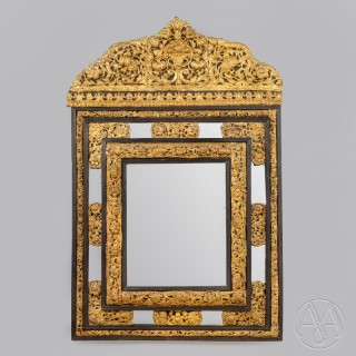 A Fine Dutch Ebonised and Repousse Gilt-Metal Cushion Mirror