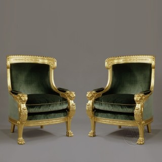 An Important Pair of Empire Style Carved Giltwood Tub Chairs