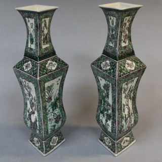 A pair of 19th century Chinese famille noire vases