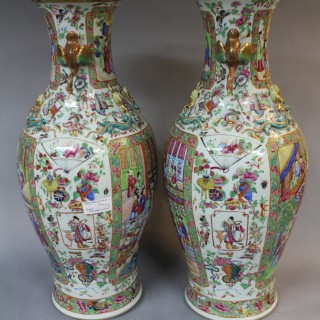A pair of mid 19th century Chinese Canton Vases with bird handles
