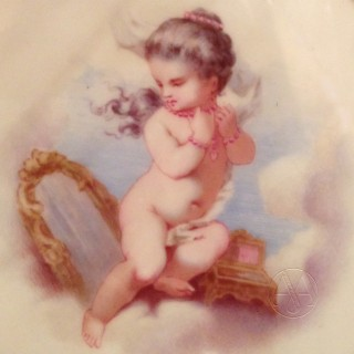 A Pair of Porcelain Plates Depicting Putto at Play