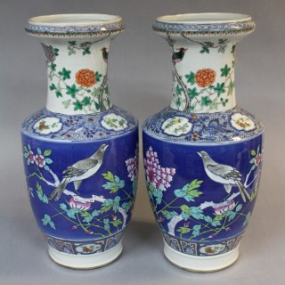 Pair 19th century Chinese vases with wrap around design of birds