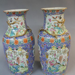 An interesting pair of 19th century Chinese polychrome vases