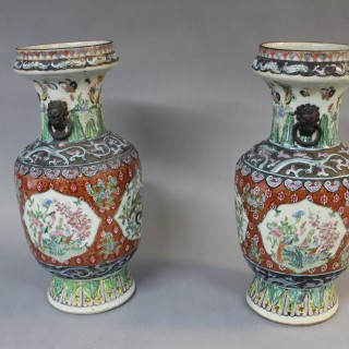 A pair of 19th century Chinese polychrome vases with crackled glaze