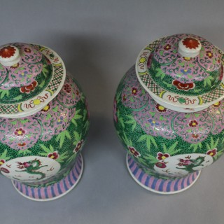 A pair of early 18th century Chinese famille verte baluster shaped jars