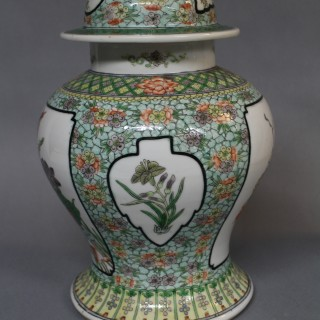 A pair of 19th century Chinese famille verte porcelain baluster shaped jars