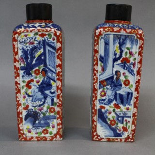 A pair of early 18th century Chinese clobbered porcelain tea canisters