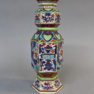 A matched pair of late 17th century Chinese clobbered porcelain vases